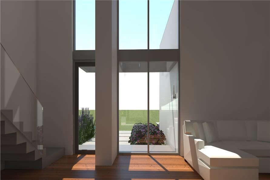 Two-story-tall light-filled area playing the part of an atrium in Modern house plan #116-1015
