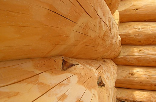 Closeup of how logs in a log cabin are fitted together in an inside corner