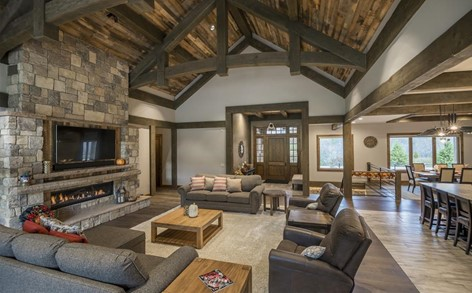 Exposed-timber vaulted ceiling in Great Room of Country Ranch home