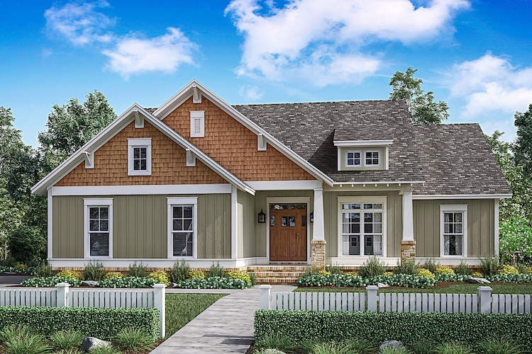 Contemporary Craftsman style home with green board-and-batten siding and cedar shakes at the gables