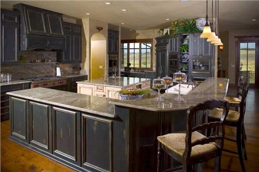 Large kitchen with peninsula eating bar in luxury Plan #161-1021