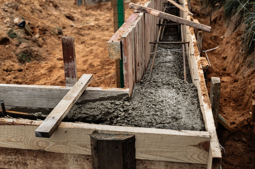 Concrete form for footing of a crawlspace foundation