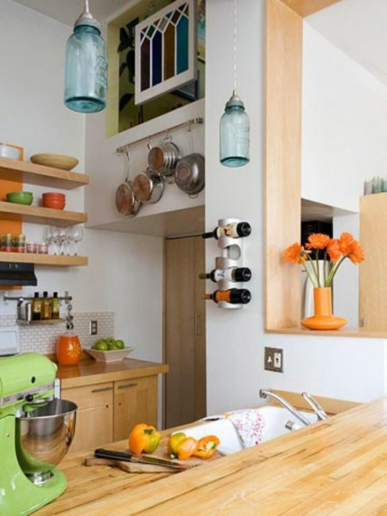 Tiny kitchen with lots of shelves for extra storage