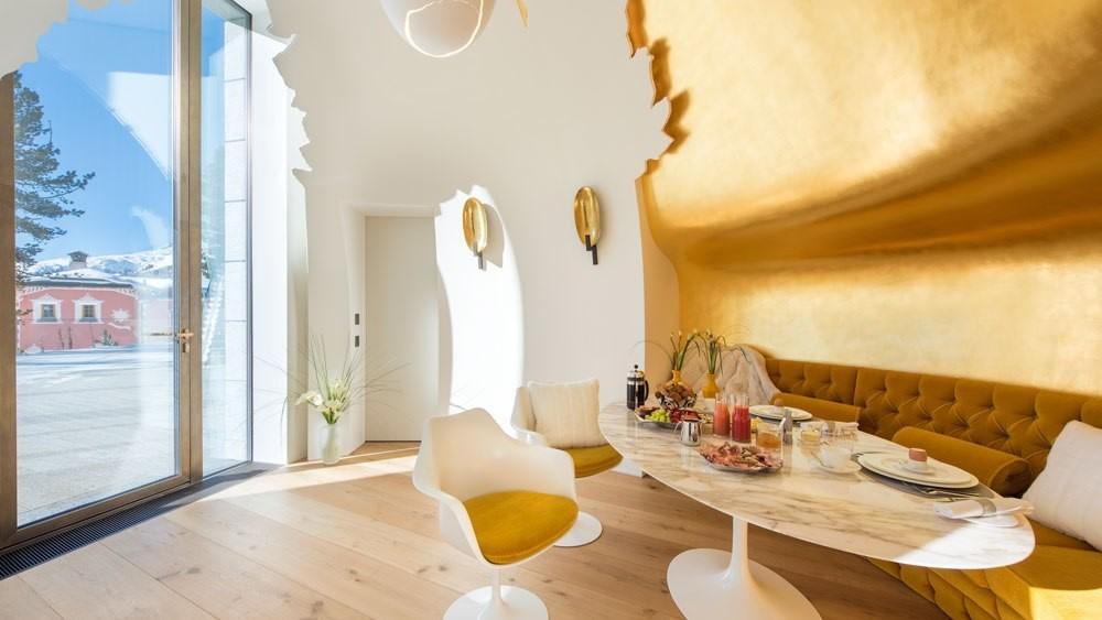 Egg-shape breakfast nook with 24-karat-gold walls