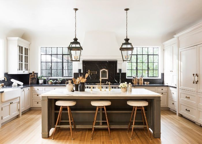 Black fixtures  hanging lights, appliances and accessories  in a kitchen