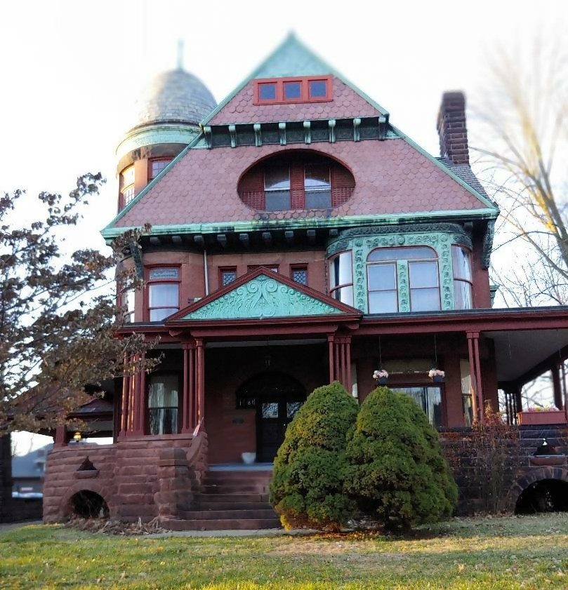 2-story Queen Anne Revival style home in an old neighborhood in the Midwest