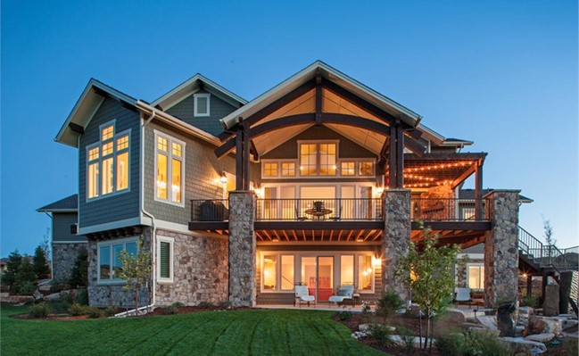 Rear of a 1-story Craftsman style home with a view of the walkout basement