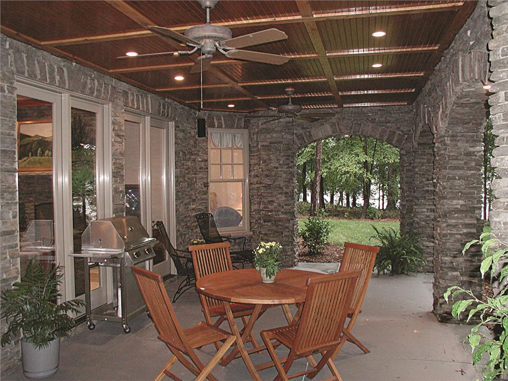 Covered patio for alfresco dining in House Plan #180-1020