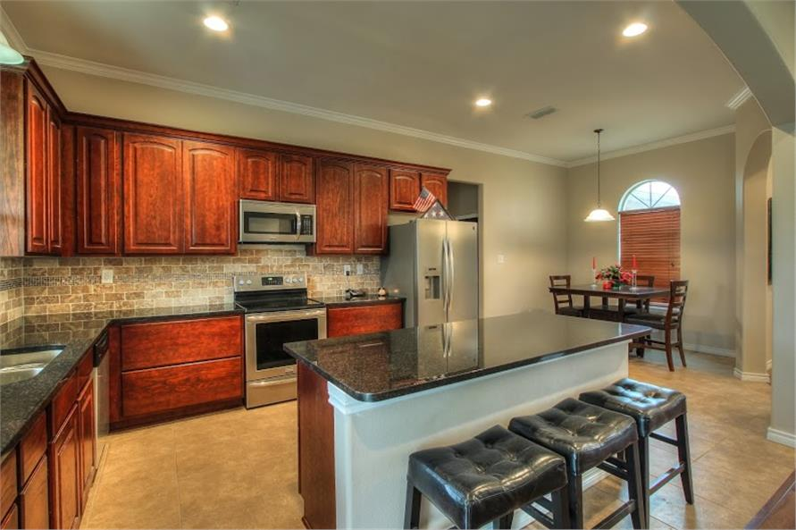 Kitchen with eating bar and breakfast nook in a 3-bedroom, 2-bath Ranch-style home