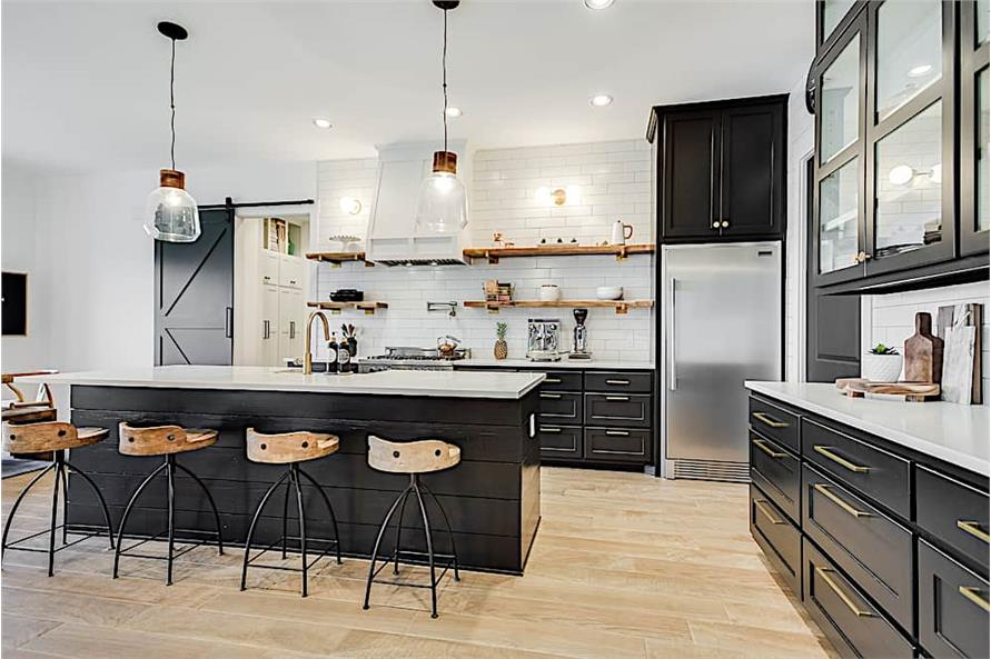 Black-and-white kitchen with decorative items on the open shelves
