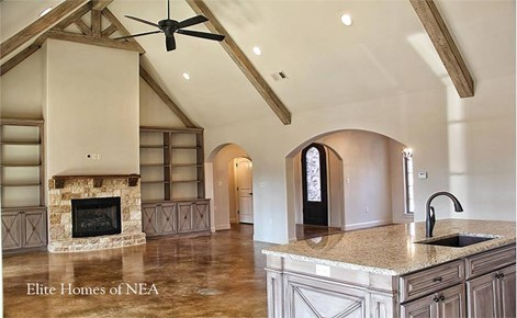 Vaulted Great Room with exposed timbers in ceiling in French style home