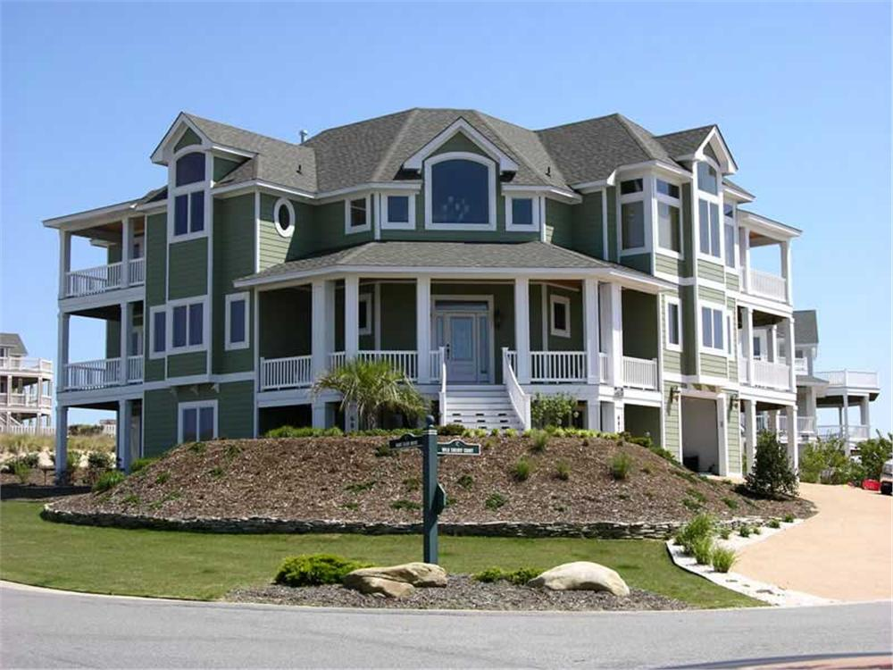3-story Coastal style home with multiple porches