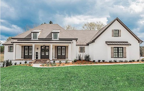 Modest French Country style home with square porch columns