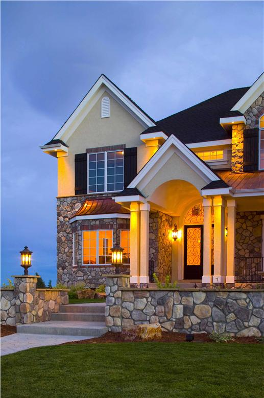 Detail of home with stone exterior, beautiful trimwork, and eye-catching windows