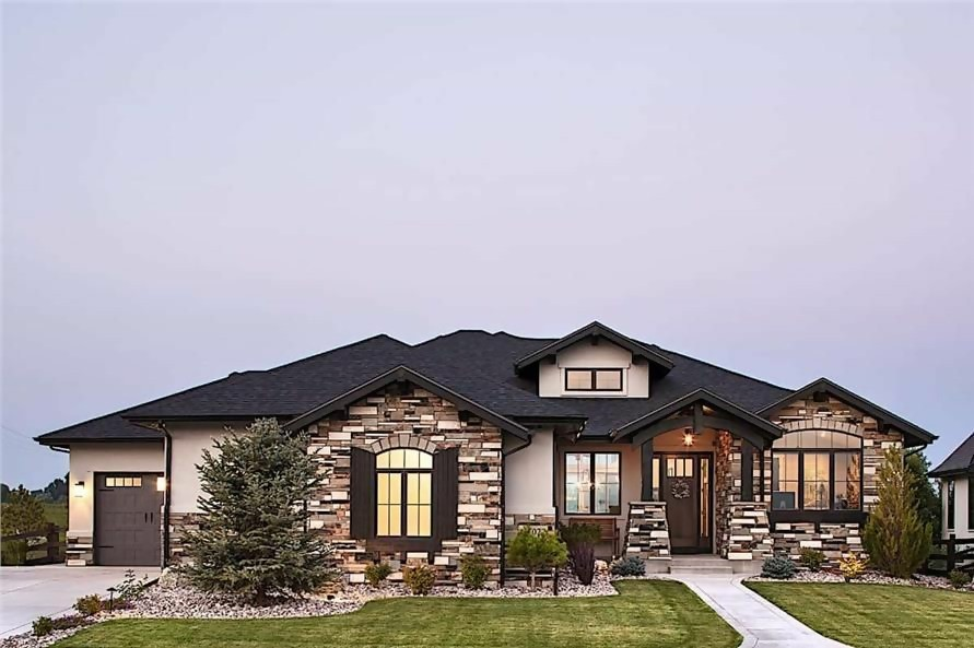 Rustic Ranch style home with cut stone block siding and hip roof