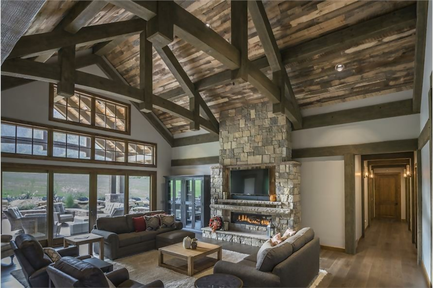 Great Room with vaulted and beamed ceiling in a Craftsman style home