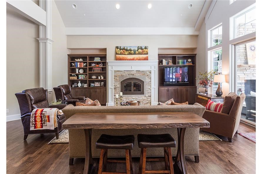 Great Room with family room that has a sizable sofa, two large leather chairs, and a cushioned chair