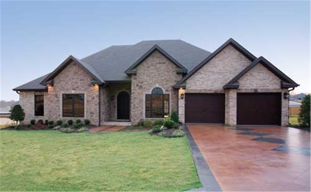 Brick home with hip roof, forward-facing gables, and 2-car garage