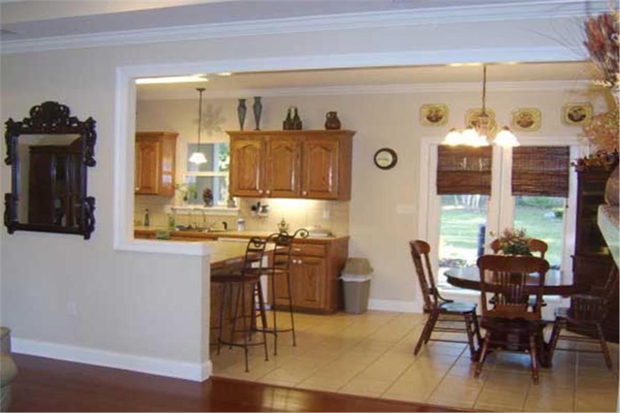 Kitchen in an open floor plan seems bigger than it is (House Plan #141-11340