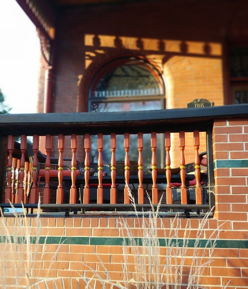Stylish, intricate, precise, and clean spindlework on Queen Anne Revival porch