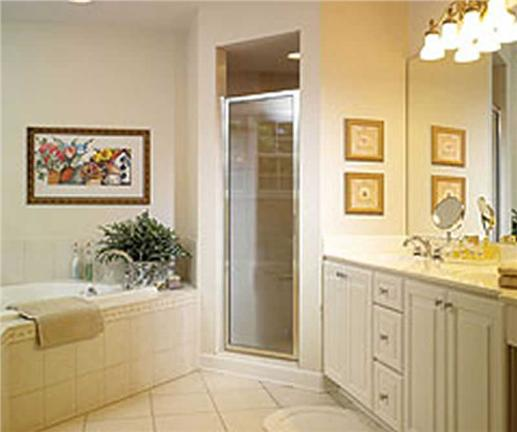Wall art helps to add color to this bathroom