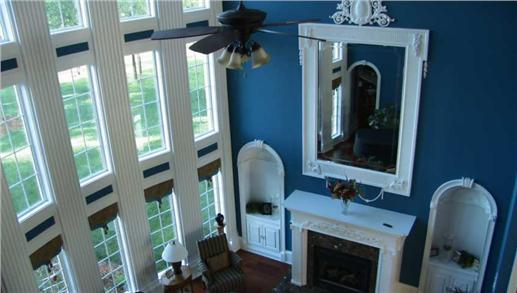 Large mirror in family room that reflects abundant light from the windows