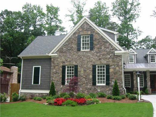 two-story, four-bedroom Arts & Crafts home with an exterior rock-stone facade has a welcoming front porch