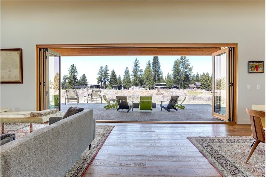 Great room in Mid-century Modern home with wide open patio door