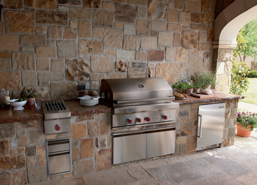 Large gas grill that forms the centerpiece of an outdoor kitchen