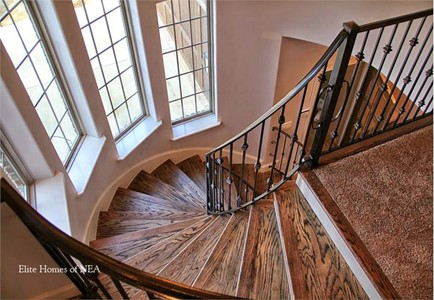 Spiral staircase flanked by tall, skinny multi-pane windows