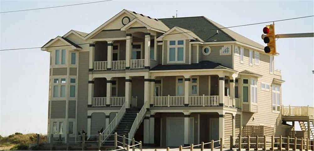 3-story Beachfront style home with large second-story front porch