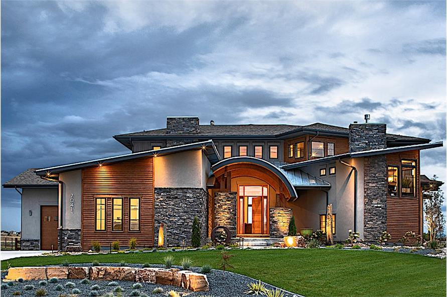 Contemporary style home with asymmetrical facade, multi-level roof, and stone-stucco-wood exterior