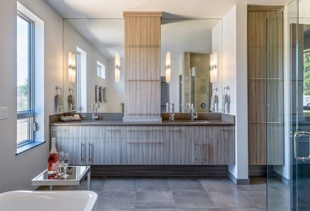 Master bath with two vanities that focuses on aesthetics and clean design