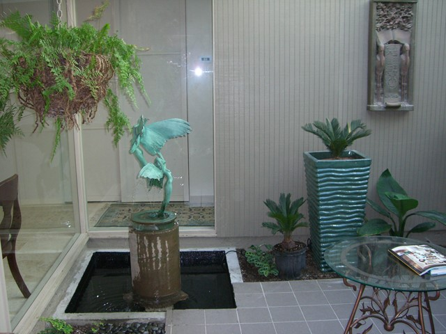 Residential atrium with water feature