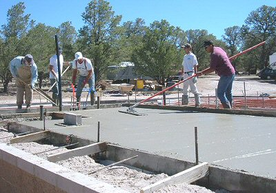 Pouring the concrete slab foundation for a new home.