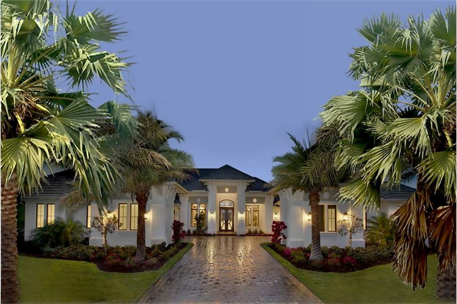 Large Florida or tropical style one-story villa with white stucco siding and hip roof