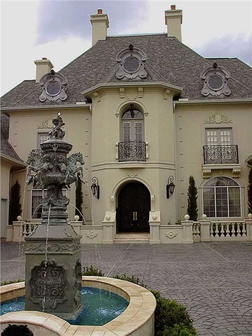Main entrance to French chateau - inspired house plan.