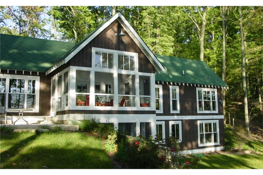 Vacation home with dark siding and large white-trimmed windows