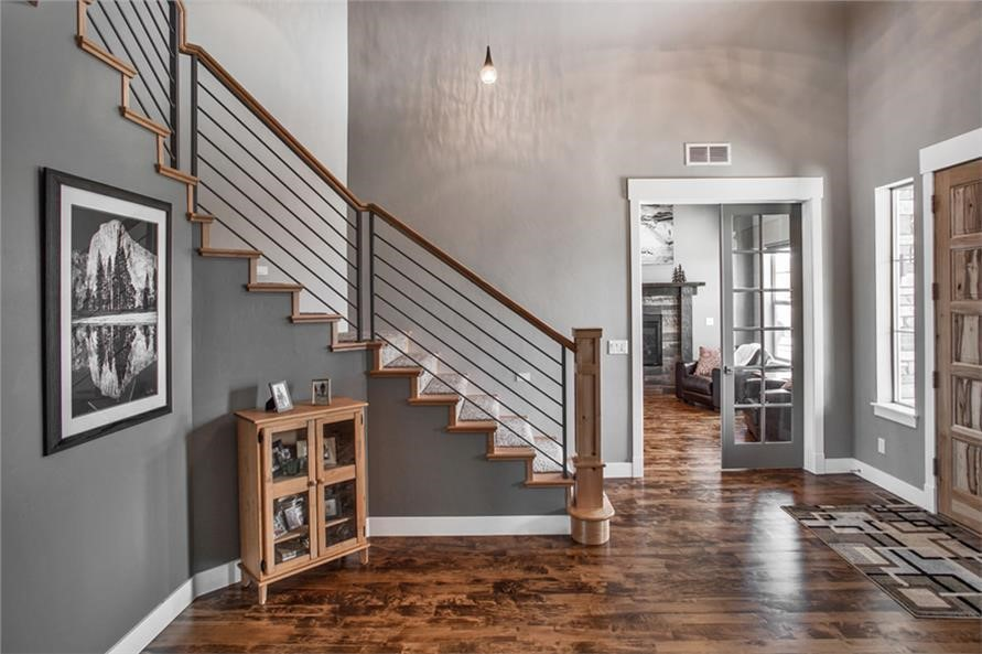 Attractive foyer highlighted by a beautiful wooden staircase in a 3,305-sq.-ft. Contemporary home
