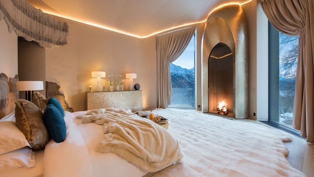 Master suite with fireplace and fur carpeting