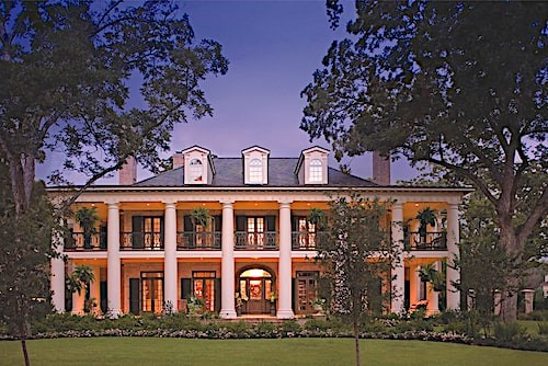 Home with prominent front columns and 2-story porch evoking a Southern plantation
