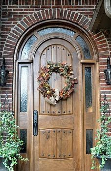Take Your Pick   Seasonal Wreaths For The Front Door. Left: Yellow Spring  Flowers In A Brick Orange Pot Provide A Perfect Contrast To The Dark Green  Door.