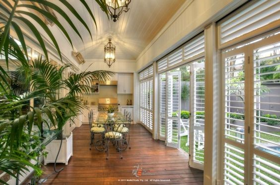 White door-size Plantation shutters in a kitchen leading to an outdoor space