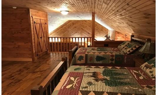 Loft sleeping area that overlooks living space below