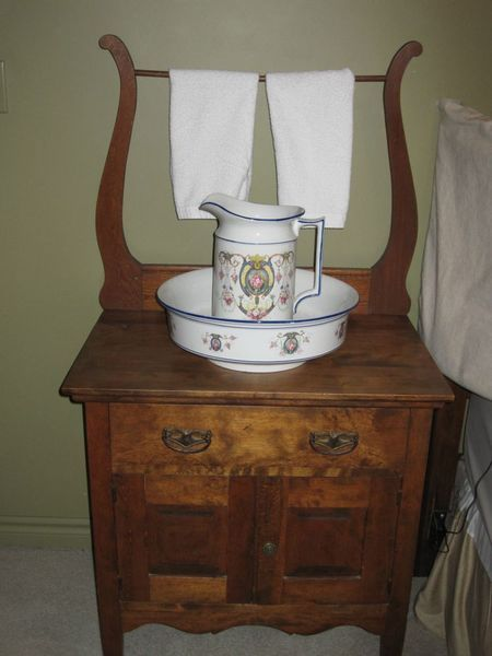 "Old washing stand as ""first vanity"""