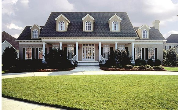 3,338-sq.-ft. Southern Plantation style home with symmetrical design and round white porch columns