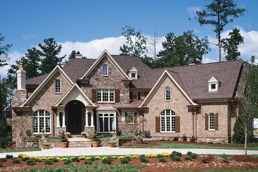 Luxurious European style home with stone and brick siding