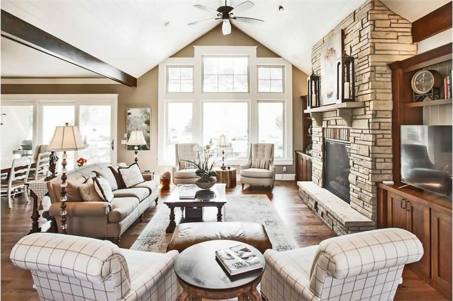 Great Room with vaulted ceiling and stone block fireplace in Ranch style home