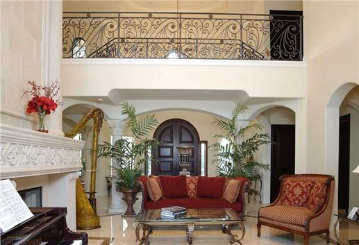 Grand foyer leads to this elegant, Spanish-style living room