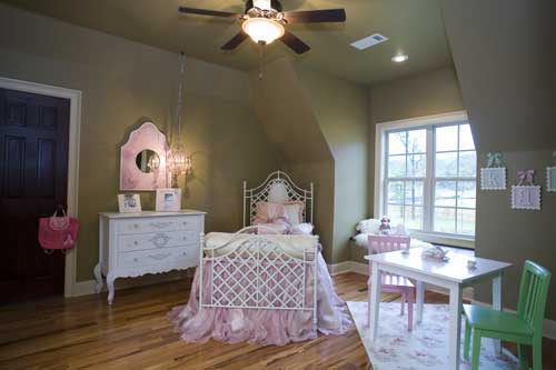 Attractively decorated little girl's bedroom in this Tudor style home